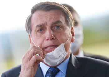 Brazil's President Jair Bolsonaro adjusts his mask as he leaves Alvorada Palace, amid the coronavirus disease (COVID-19) outbreak in Brasilia, Brazil May 13, 2020. REUTERS/Adriano Machado     TPX IMAGES OF THE DAY