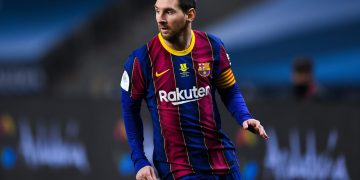 SEVILLE, SPAIN - JANUARY 17: Lionel Messi of FC Barcelona looks on during the Supercopa de Espana Final match between FC Barcelona and Athletic Club at Estadio de La Cartuja on January 17, 2021 in Seville, Spain. Sporting stadiums around Spain remain under strict restrictions due to the Coronavirus Pandemic as Government social distancing laws prohibit fans inside venues resulting in games being played behind closed doors. (Photo by David Ramos/Getty Images)