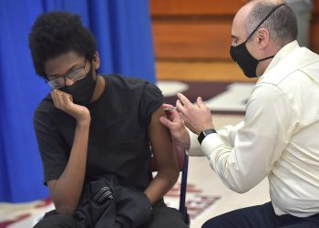Lansdowne, PA. May 6 : Payton Mensah, 16 gets his Pfizer-biontech vaccination Thursday at a vaccination clinic for students from the William Penn and Southeast Delco School Districts may 6, 2021.  (Photo by Pete Bannan/MediaNews Group/Daily Times via Getty Images)